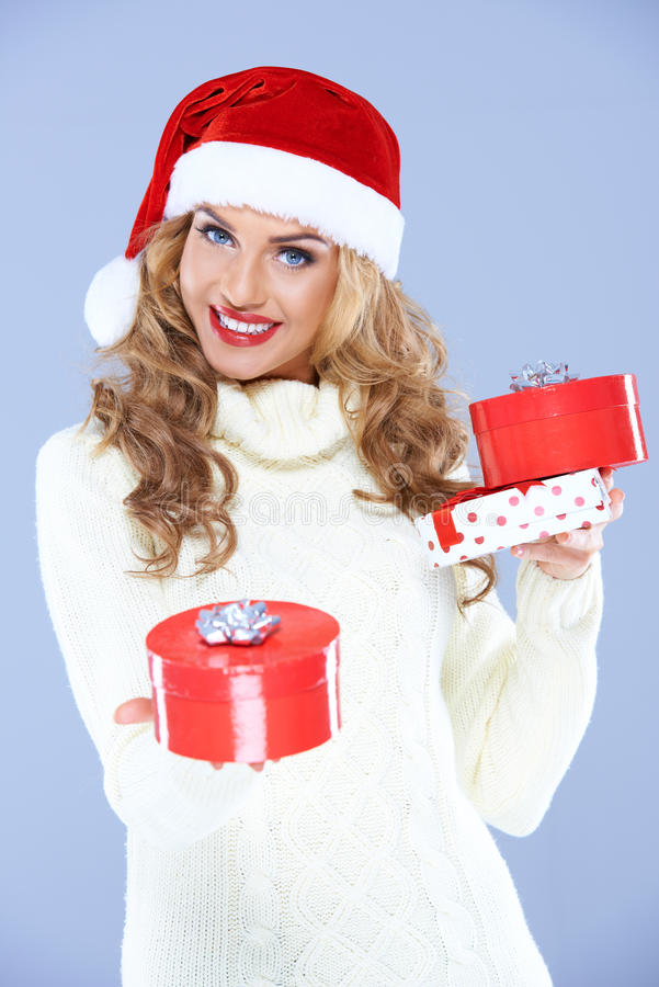 Download Pretty Woman In Santa Hat Holding Christmas Gifts Stock Image - Image: 27142279