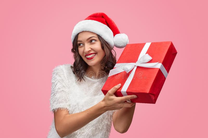 Cheerful female shaking Christmas present royalty free stock photography