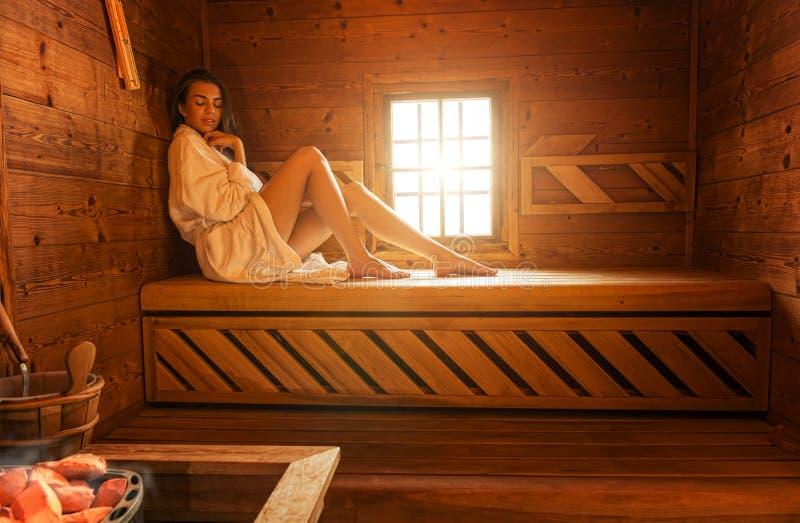 Pretty woman in sauna stock image