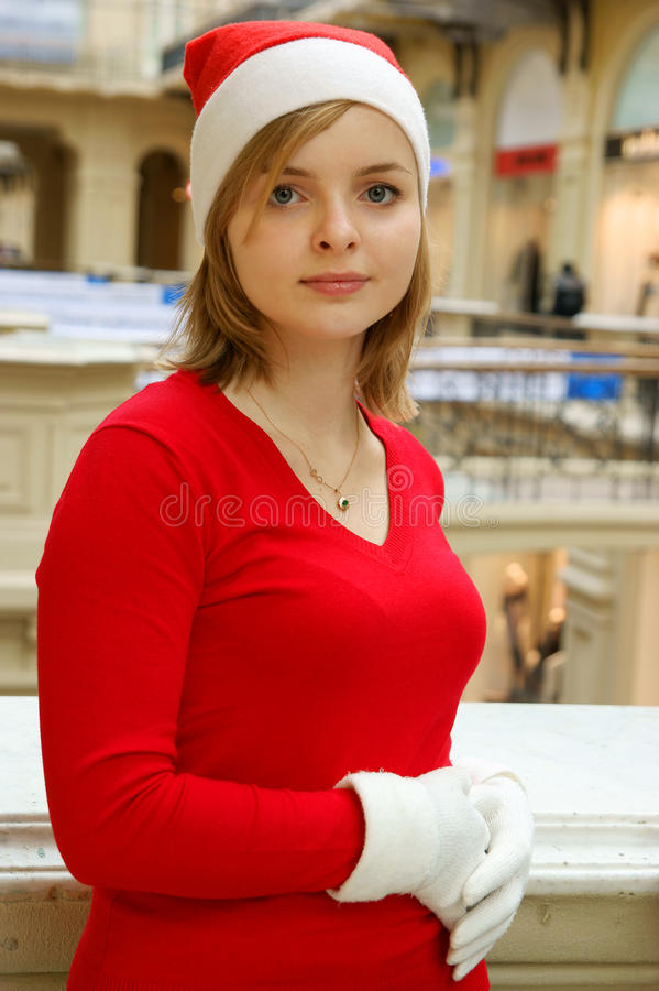 Pretty woman at the shop in santa hat stock images