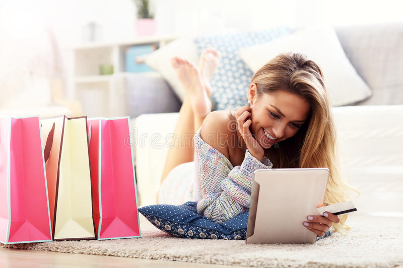 Pretty woman shopping online with credit card. Picture showing pretty woman shopping online with credit card stock photo