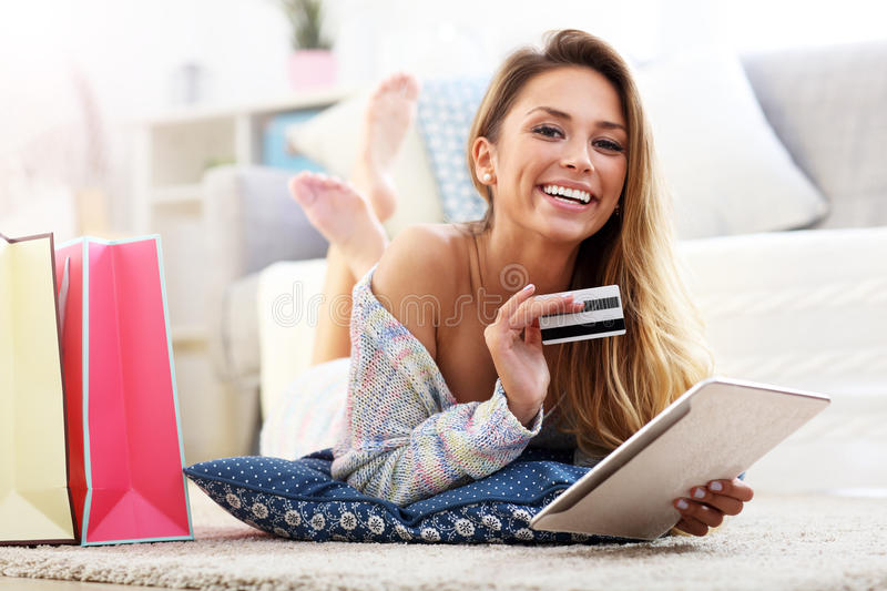 Pretty woman shopping online with credit card. Picture showing pretty woman shopping online with credit card royalty free stock image