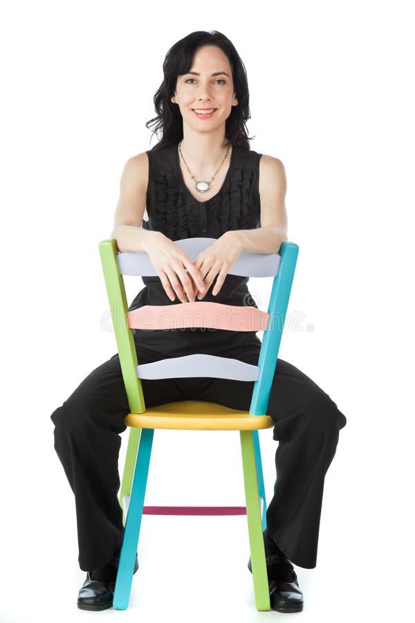 Pretty woman sitting on a colorful chair