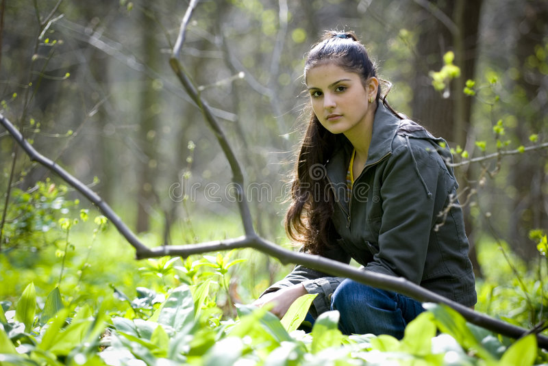Pretty woman sitting in forest stock photos