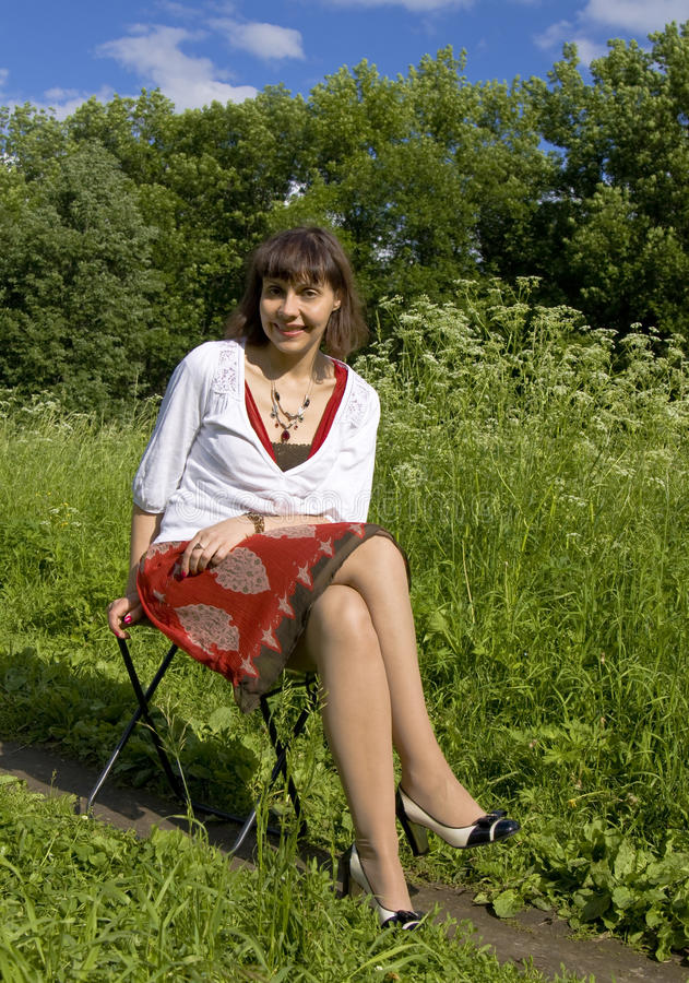 Pretty Woman Sitting In Park Stock Photo - Image of nature ...
