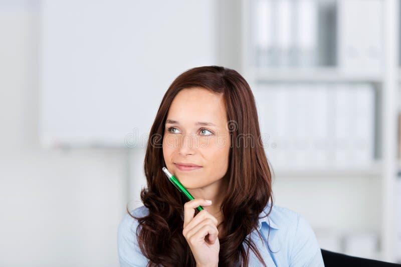 Pretty woman sitting thinking royalty free stock photos