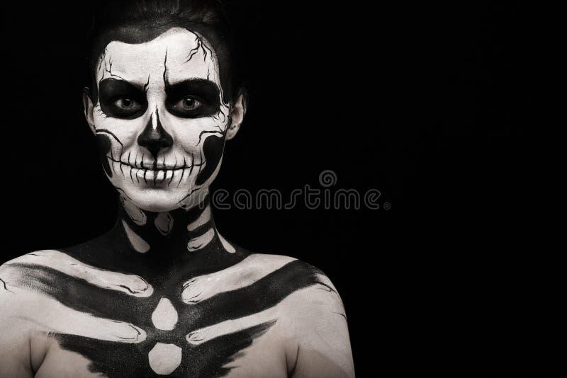 Pretty woman with skeleton tattoo royalty free stock photos