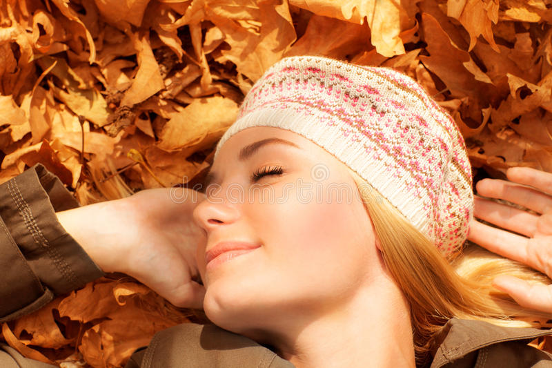 Download Pretty Woman Sleeping On Fall Foliage Stock Photo - Image: 27353468