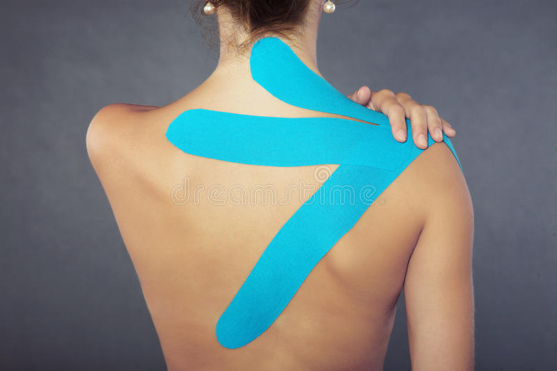 Pretty woman with sports taping on the body royalty free stock images