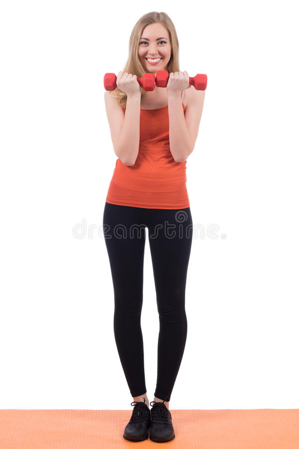 Pretty woman in sportswear exercising hands with the dumbbells. stock image