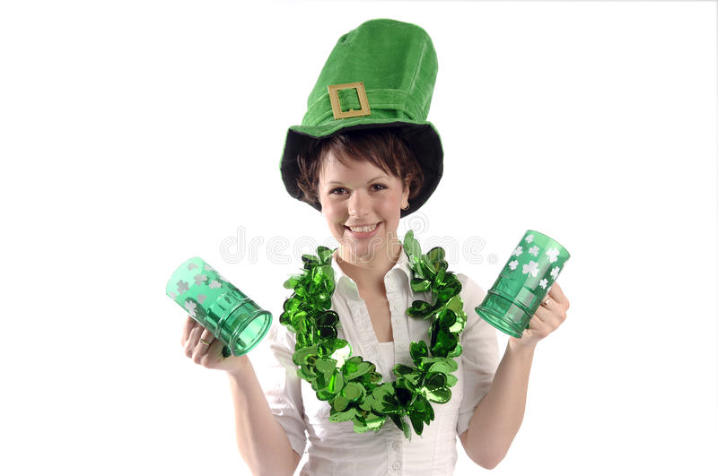 Pretty woman on St. Patrick's day. Young pretty woman wearing green hat celebrate St Patrick's day royalty free stock photos