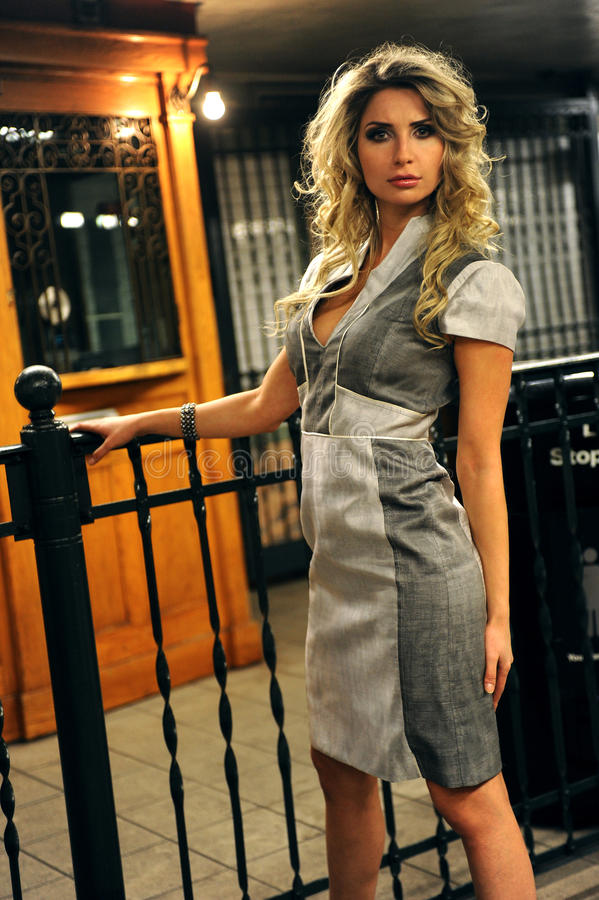 Pretty Woman Standing By Old Token Booth Stock Image