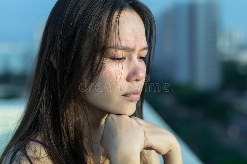 Sad woman depressed on her balcony royalty free stock photo
