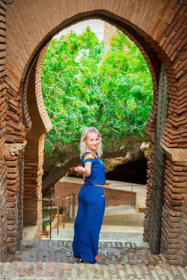 Pretty woman stands in medieval fortress stock photography