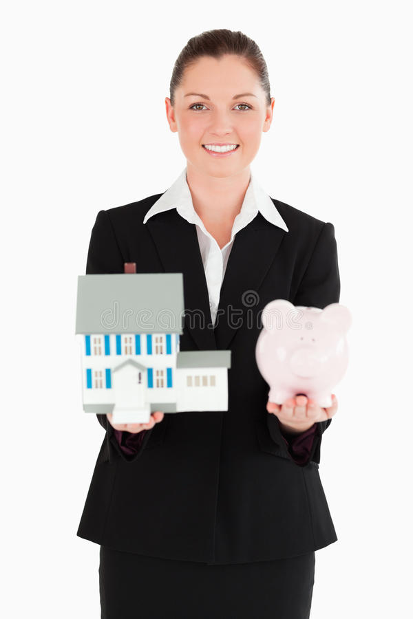 Download Pretty Woman In Suit Holding A Piggy Stock Photo - Image: 20363724