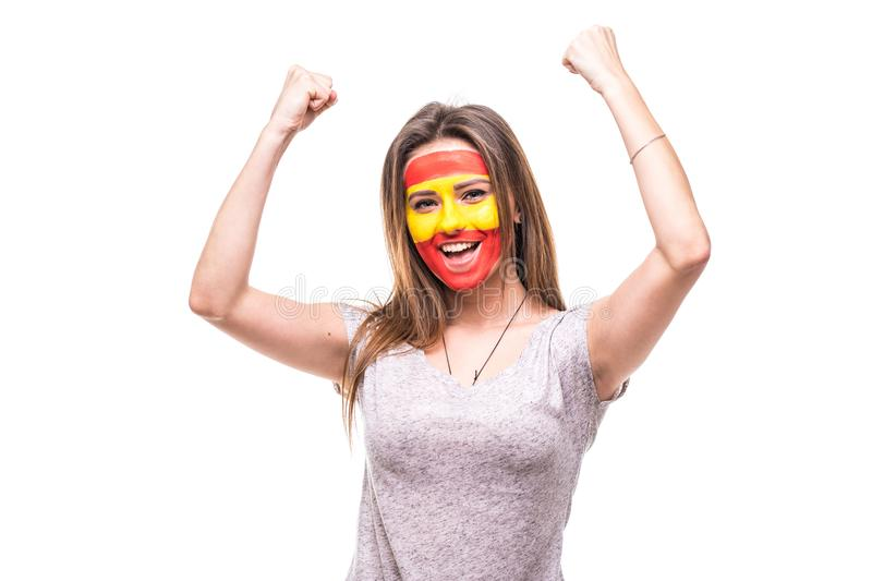 Pretty woman supporter fan of Spain national team painted flag face get happy victory screaming into a camera. Fans emotions. royalty free stock photo