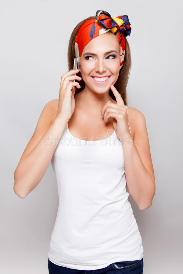 Pretty woman talking on the phone. Beautiful happy woman having a good idea while talking on the phone royalty free stock photos