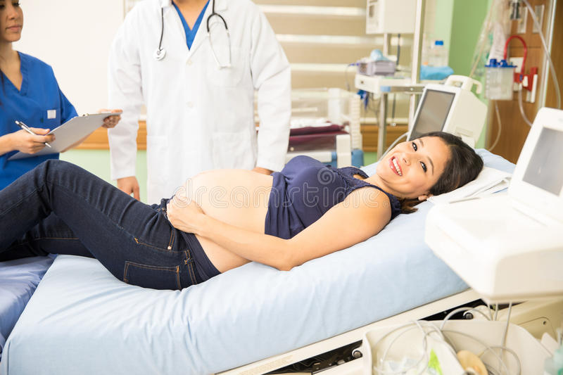 Pretty woman about to go into labor royalty free stock photography