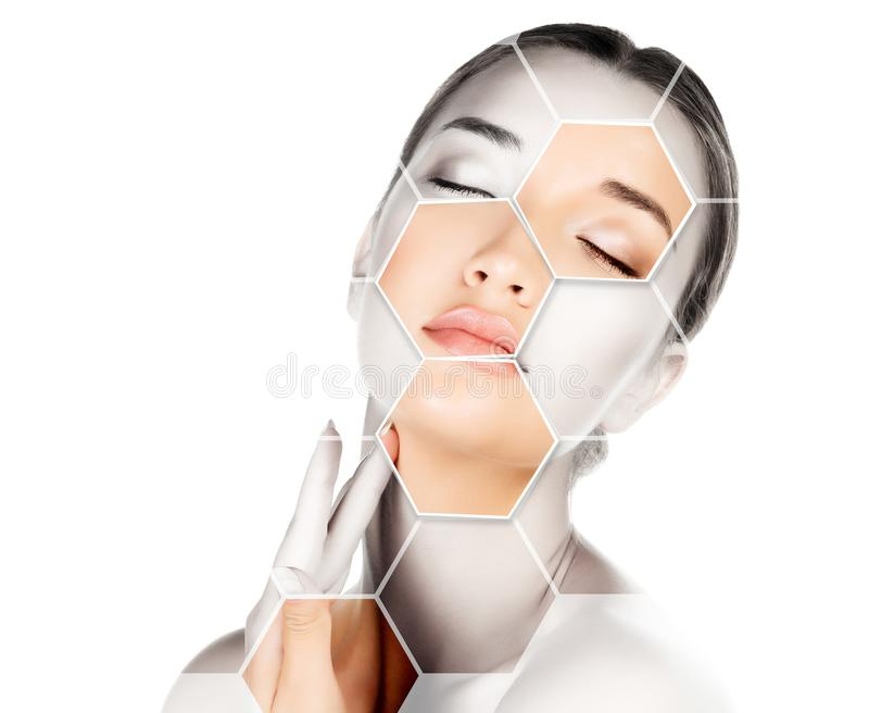 Pretty woman is touching her face royalty free stock image