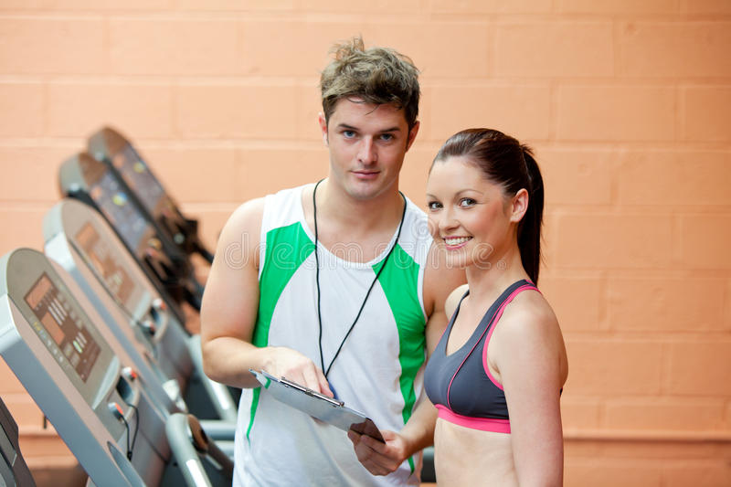 Download Pretty Woman On A Treadmill With Her Coach Stock Photo - Image: 16347532
