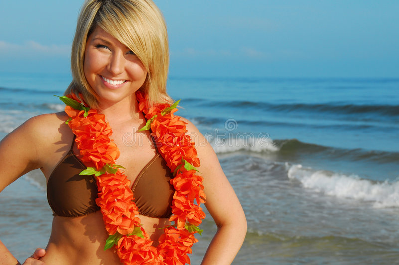 Pretty woman on tropical beach stock image