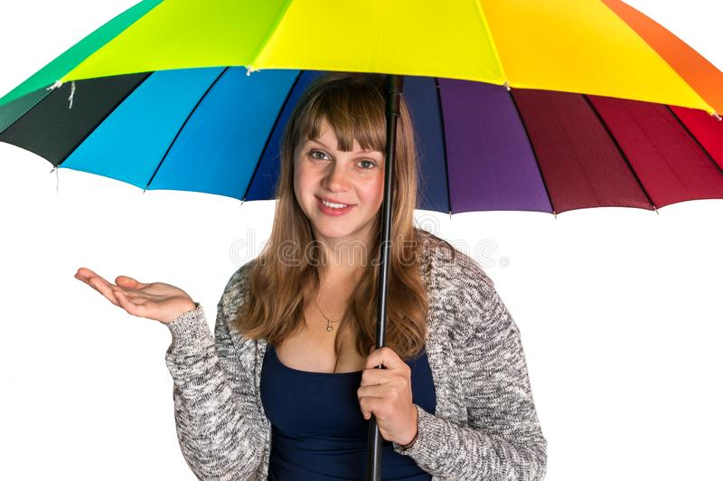 Pretty woman under colorful umbrella isolated on white. Background stock photography
