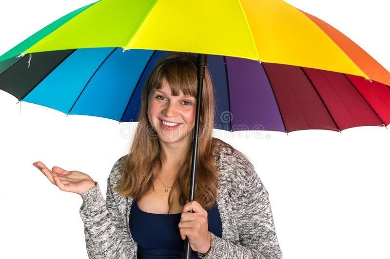 Pretty woman under colorful umbrella isolated on white royalty free stock image