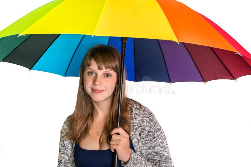 Pretty woman under colorful umbrella isolated on white stock photo