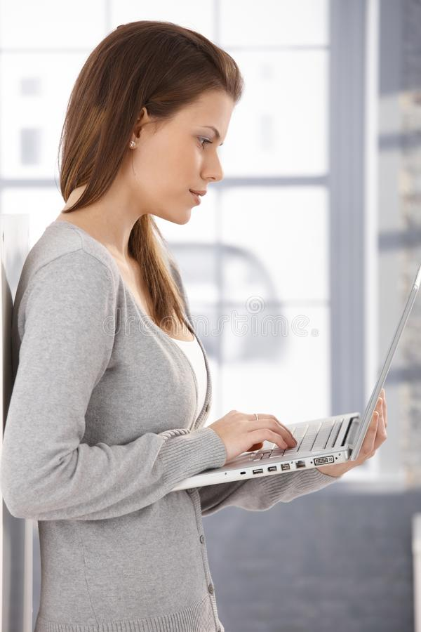 Pretty woman using laptop at home