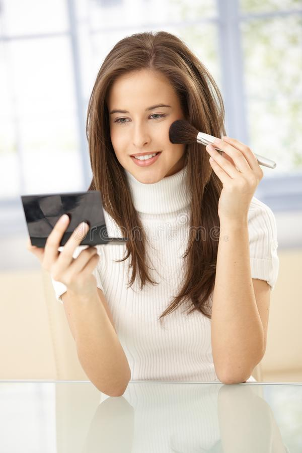 Download Pretty woman using makeup stock image. Image of apply - 18760327