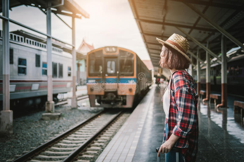 Pretty woman waiting the train at train station for travel in summer. Travel concept. royalty free stock photo
