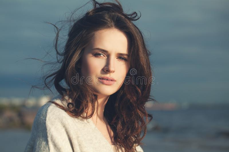 Pretty woman walking along the coastline of the sea. Meditative girl relaxing outdoor stock photos