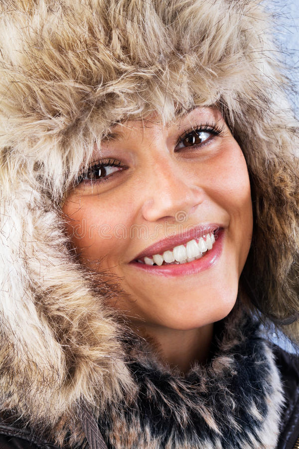 Pretty woman with warm fur hat royalty free stock photos
