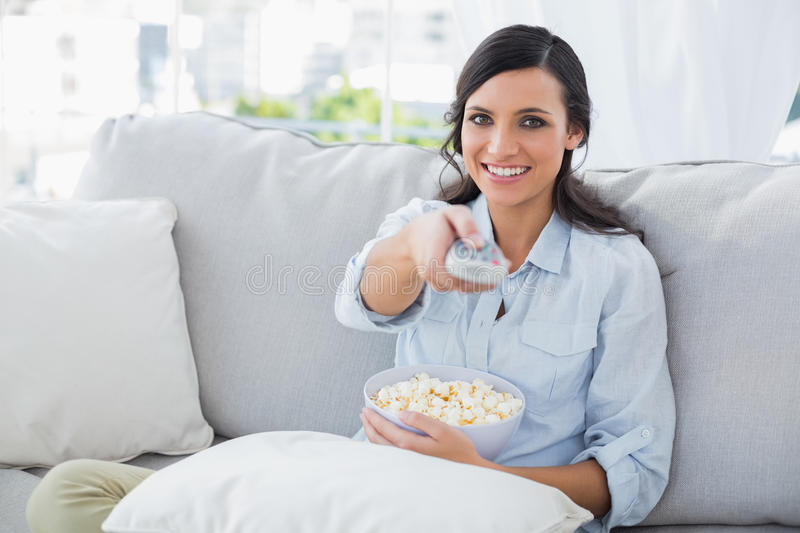 Download Pretty Woman Watching Tv With Popcorn Stock Image - Image: 33052483