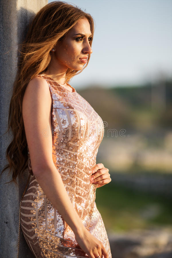 Pretty woman is wearing luxury dress stock image