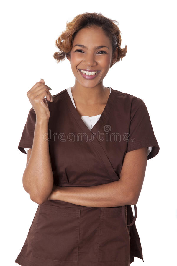 Pretty woman wearing scrubs smiles and laughs. Happy woman stands smiling in scrubs, isolated on white background stock photo