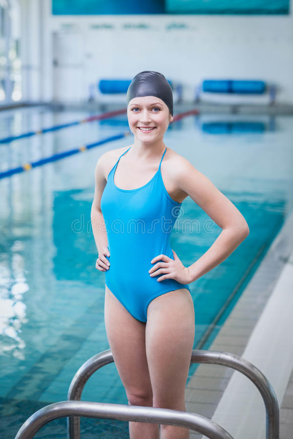 Pretty woman wearing swim cap. At the pool royalty free stock photos
