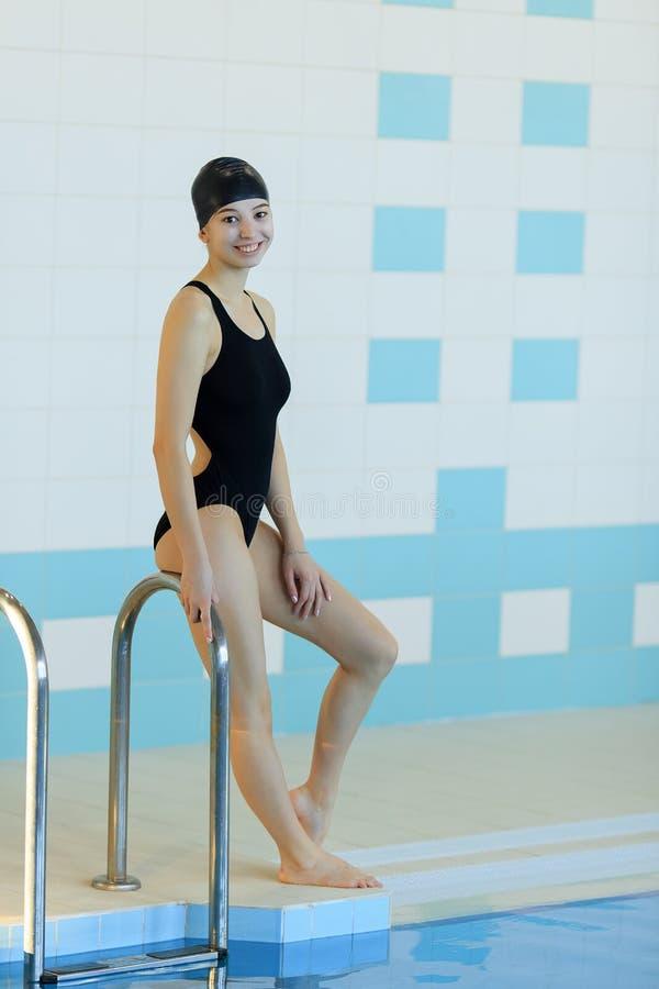 Pretty woman wearing swim cap at the pool.  royalty free stock photo