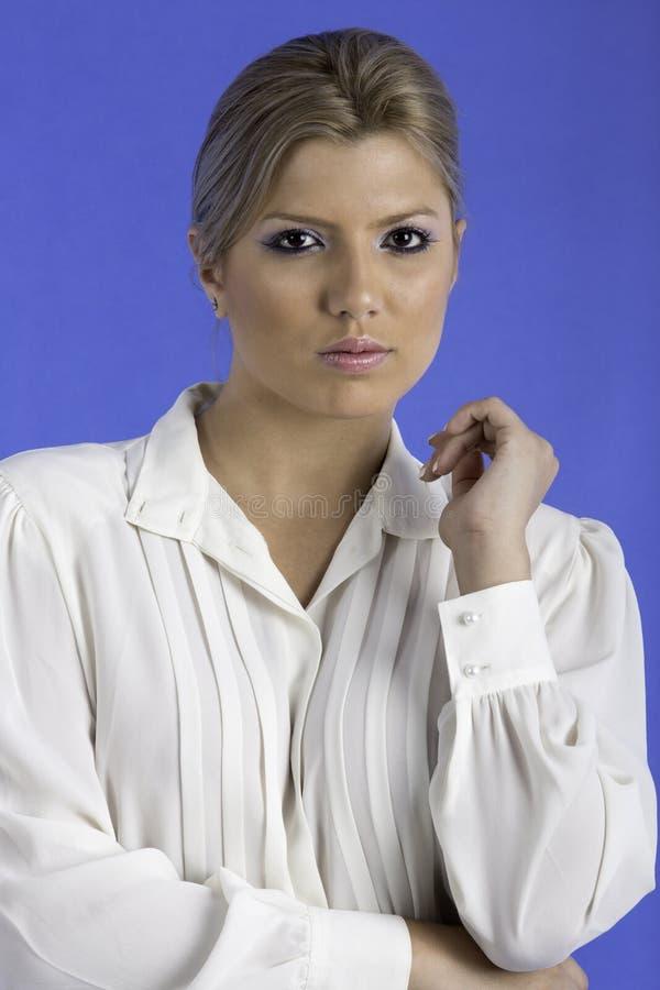 Pretty woman wearing a white shirt. royalty free stock photos