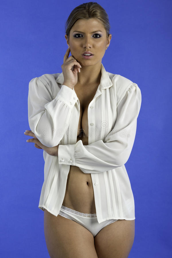 Pretty woman only wearing a white shirt. stock photos