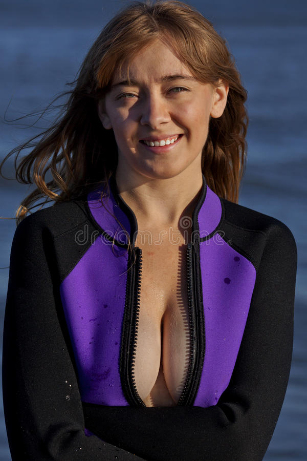 Pretty woman in wetsuit stock image