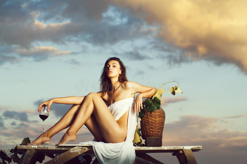 Pretty woman with wine over sky stock photos