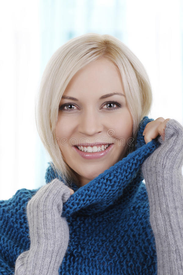 Pretty woman with winter pullover stock images