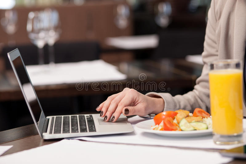 Pretty woman working with a notebook in restaurant royalty free stock photo