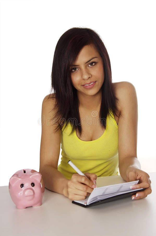 Pretty woman writing a check stock photos