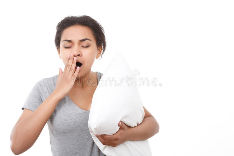 Pretty woman yawning on white isolated background royalty free stock photos