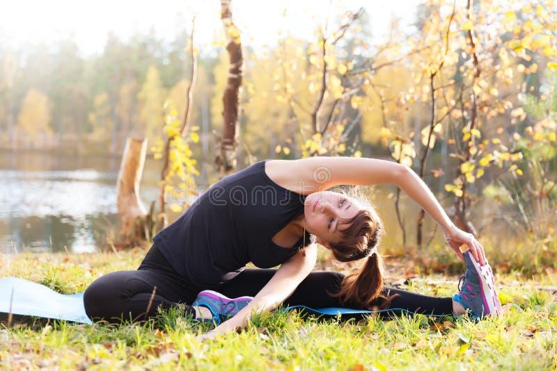 Pretty woman yoga Parivrtta Janu Sirsasana Head to Knee pos royalty free stock images