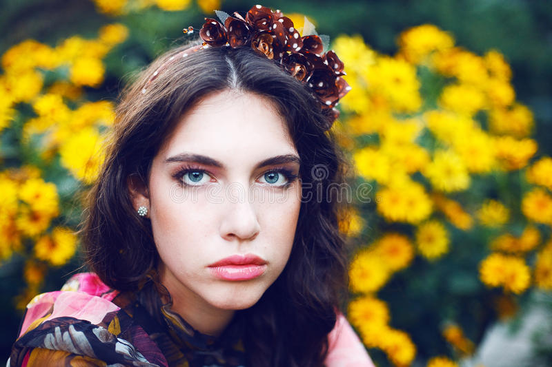 Pretty women in the garden stock images