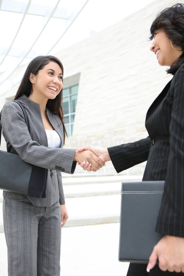 Download Pretty Women At Office Building Shaking Hands Stock Image - Image: 5334677