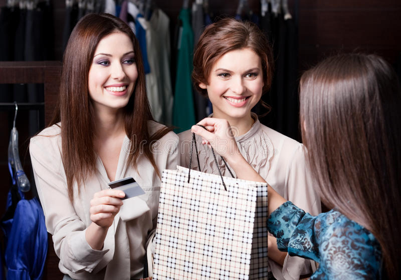 Women pay charges account with credit card stock images